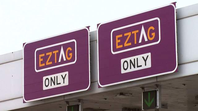 Signs indicate lanes that only accept EZ Tags on a Houston-area toll road in this undated image.