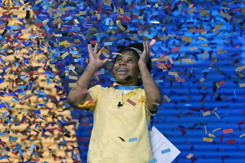Zaila Avant-garde, 14, from Harvey, Louisiana is covered with confetti as she celebrates winning the finals of the 2021 Scripps National Spelling Bee at Disney World Thursday, July 8, 2021, in Lake Buena Vista, Fla. (AP Photo/John Raoux)