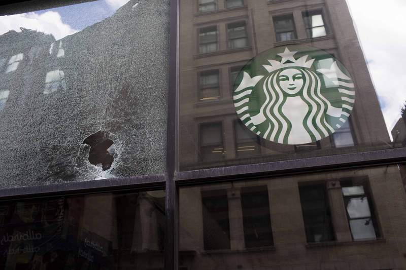 NEW YORK, NY - JUNE 1: A broken glass of a Starbucks is seen after a protest against the death in Minneapolis police custody of George Floyd at SoHo neighborhood on June 1, 2020 in the Soho neighborhood of New York City. New York City is under a curfew from Monday night to curb violent protests following the death of black man George Floyd, according to a joint statement by Mayor Bill de Blasio and New York State Governor Andrew Cuomo on Monday. (Photo by Andrew Lichtenstein/Corbis via Getty Images)