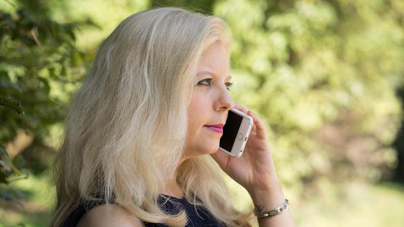 A stock photo of a woman on the phone.