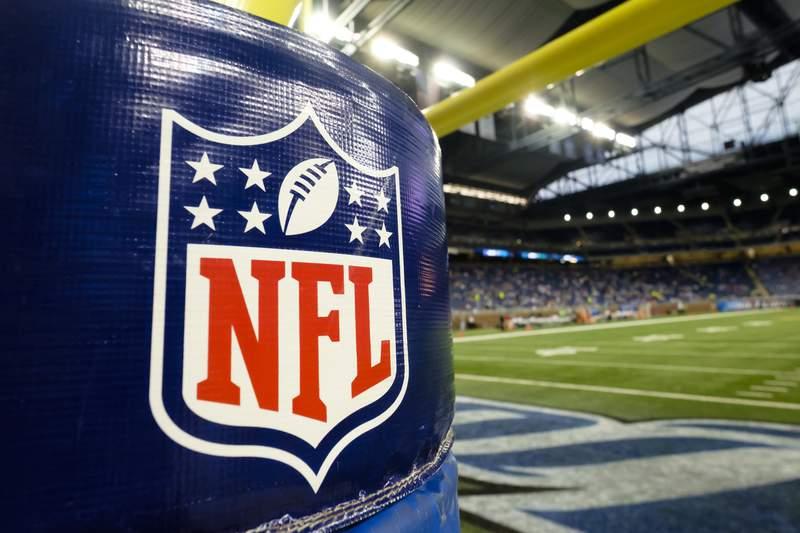FILE - In this Thursday, Aug. 13, 2015 file photo, NFL Logo is seen on the goal post padding before an NFL preseason football game between the Detroit Lions and the New York Jets at Ford Field in Detroit. The process of building the NFL schedule used to be a painstaking one with executives like Val Pinchbeck spending months slotting the games one by one on his board until there was a final product for the commissioner to approve. Making late tweaks or looking at alternative options with a big game moving from early to late in the season weren't really possible for all the pieces of the complicated jigsaw puzzle to fit.(AP Photo/Rick Osentoski, File)