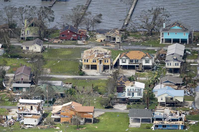 Buildings and homes are damaged in the aftermath of Hurricane Laura Thursday, Aug. 27, 2020, near Lake Charles, La. (AP Photo/David J. Phillip)