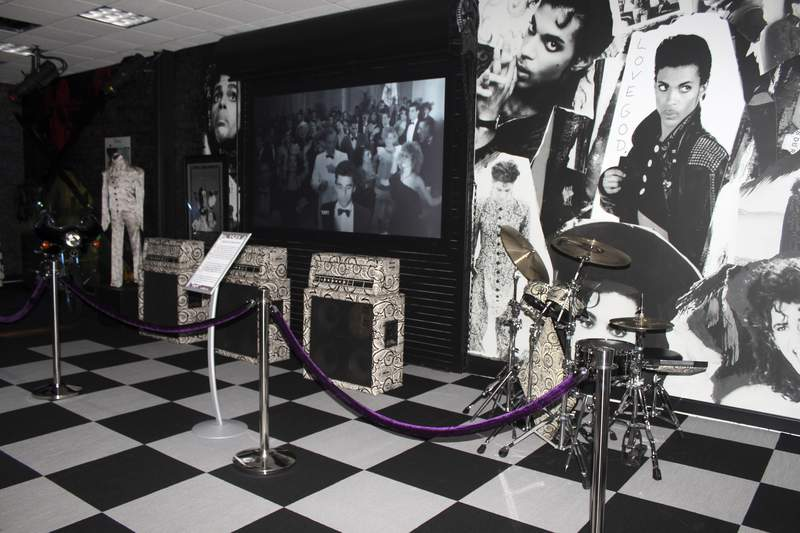 FILE - Amplifiers and a drum kit are on display at Prince's Paisley Park on Nov. 2, 2016, in Chanhassen, Minn. Paisley Park officials are marking the fifth anniversary of Prince's death by offering fans free admission to pay their respects in the suburban Minnesota compound, where his ashes will be on display in the atrium. (AP Photo/Jeff Baenen, File)