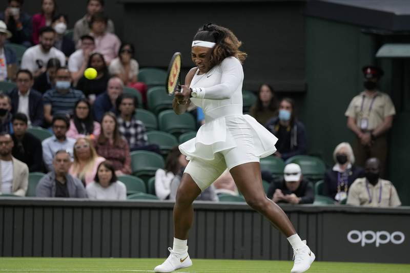Serena Williams of the US plays a return to Aliaksandra Sasnovich of Belarus for the women's singles first round match on day two of the Wimbledon Tennis Championships in London, Tuesday June 29, 2021. (AP Photo/Kirsty Wigglesworth)