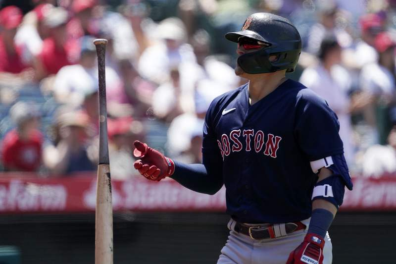 Boston Red Sox's Kik Hernandez flips his bat after striking out during the fifth inning of a baseball game against the Los Angeles Angels Wednesday, July 7, 2021, in Anaheim, Calif. (AP Photo/Mark J. Terrill)