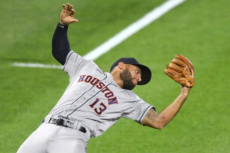 BALTIMORE, MD - JUNE 21: Abraham Toro #13 of the Houston Astros catches a pop up in the sixth inning hit by Maikel Franco #3 (not pictured) of the Baltimore Orioles during a game at Oriole Park at Camden Yards on June 21, 2021 in Baltimore, Maryland. (Photo by Mitchell Layton/Getty Images)
