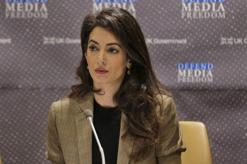 FILE - In this Wednesday, Sept. 25, 2019 file photo, attorney Amal Clooney listens during a panel discussion on media freedom at United Nations headquarters. British human rights lawyer Amal Clooney was named Friday Sept. 17, 2021, as one of 17 special advisers to the new chief prosecutor of the International Criminal Court. (AP Photo/Seth Wenig, File)