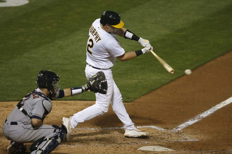 OAKLAND, CALIFORNIA - SEPTEMBER 07: Sean Murphy #12 of the Oakland Athletics hits a two-run single in the bottom of the eighth inning against the Houston Astros at Oakland-Alameda County Coliseum on September 07, 2020 in Oakland, California. (Photo by Lachlan Cunningham/Getty Images)
