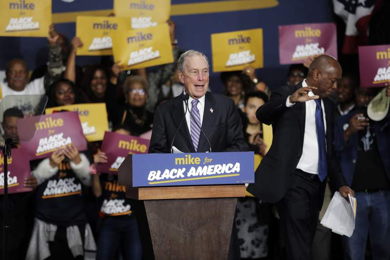 Democratic presidential candidate and former New York City Mayor Michael Bloomberg speaks during a campaign rally at the Buffalo Soldier Museum in Houston, Thursday, Feb. 13, 2020. Houston Mayor Sylvester Turner stands at right. (Elizabeth Conley/Houston Chronicle via AP)