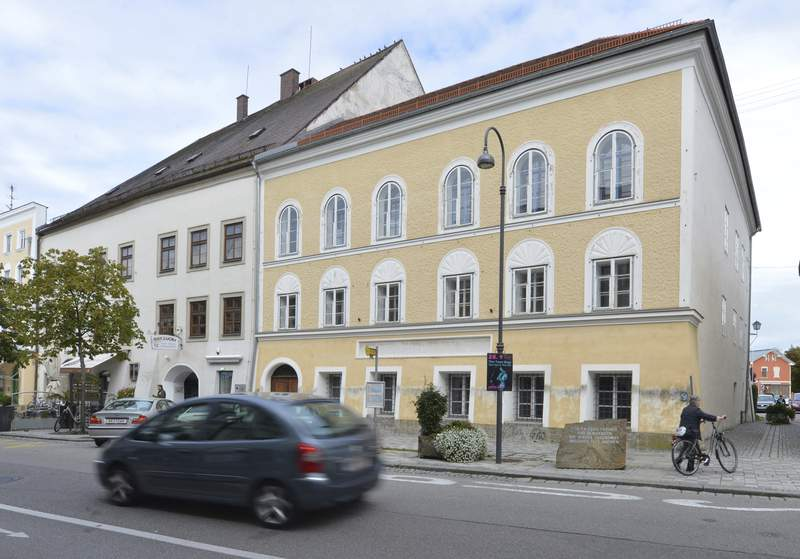 ADDS DATE - FILE - This Sept. 27, 2012 file picture shows an exterior view of Adolf Hitler's birth house, front, in Braunau am Inn, Austria. The birth house of Adolf Hitler will become a police station Austrian interior minister Karl Nehammer said, as he presents the redesign of the building at a news conference in Vienna Tuesday, June 2, 2020. (AP Photo/Kerstin Joensson,file)