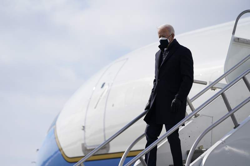 President Joe Biden arrives at Kalamazoo Battle Creek International Airport to visit a Pfizer manufacturing site, Friday, Feb. 19, 2021, in Portage, Mich. (AP Photo/Evan Vucci)
