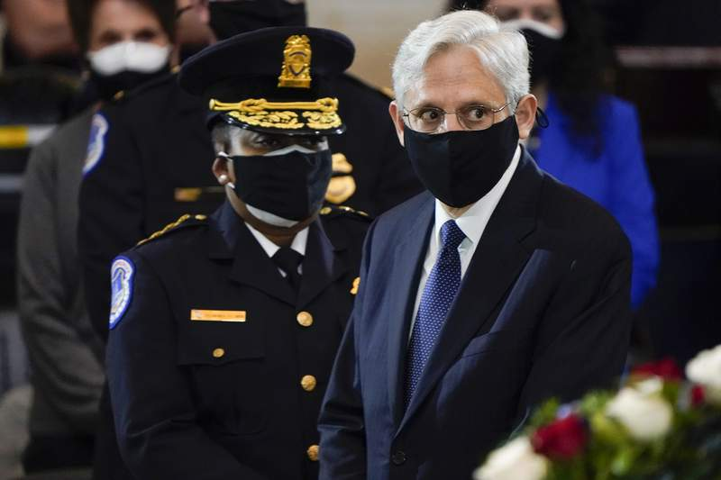 """Attorney General Merrick Garland and acting U.S. Capitol Police chief Yogananda Pittman attend a service for slain U.S. Capitol Police officer William """"Billy"""" Evans who lies in honor at the Capitol in Washington, Tuesday, April 13, 2021. (AP Photo/J. Scott Applewhite, Pool)"""