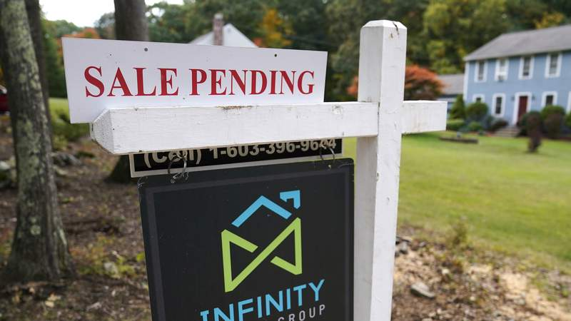 FILE - In this Sept. 29, 2020 file photo, a sale pending sign is displayed outside a residential home for sale in East Derry, N.H. The number of Americans signing contracts to buy homes fell for the second straight month as lack of available homes continue to stifle house hunters. The National Association of Realtors said Monday, Nov. 30 that its index of pending sales fell 1.1%, to 128.9 in October, down from a reading of 130.3 in September. (AP Photo/Charles Krupa, File)