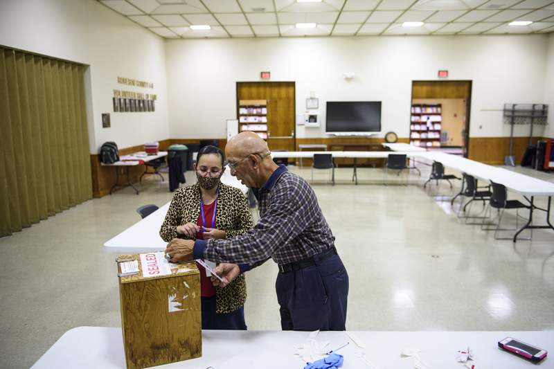Volunteers seal a ballot box at the O.P. Owens Agricultural Center before bringing the information to the Robeson County Board of Elections on Nov. 3, 2020 in Lumberton, North Carolina.