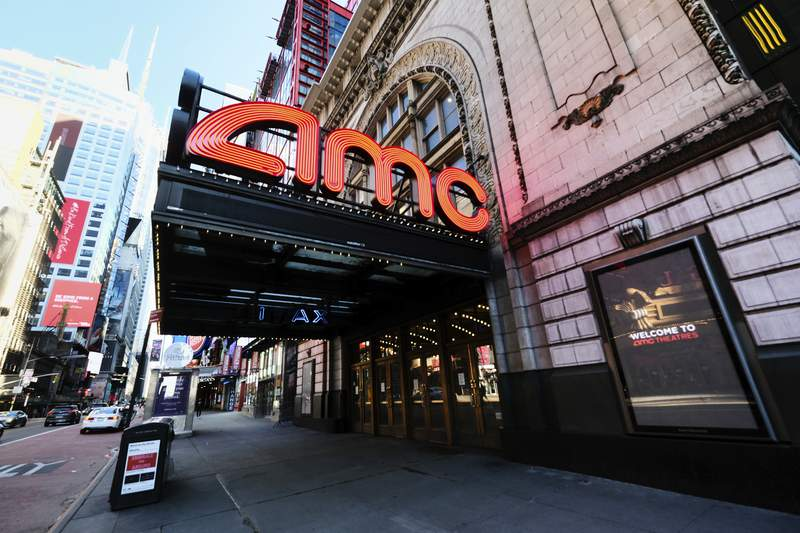FILE - In this May 13, 2020 file photo, AMC Empire 25 theatre appears on 42nd Street in New York. Last weekend, theaters were cleared to open begin opening in some New York State counties at under 50% capacity and this weekend San Francisco will join in too. New York City and Los Angeles remain closed, however. AMC Theaters and Cinemark are largely up and running. Approximately 54% of screens are open in the U.S., according to the National Association of Theater Owners.  (Photo by Evan Agostini/Invision/AP, File)