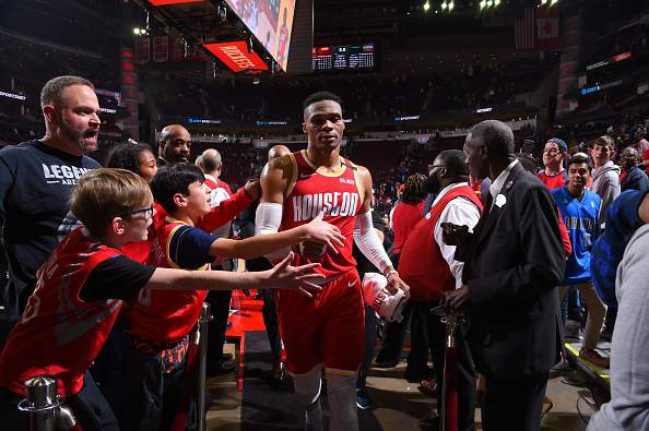 HOUSTON, TX - FEBRUARY 2 : Russell Westbrook #0 of the Houston Rockets high fives fans after the game against the New Orleans Pelicans on February 2, 2020 at the Toyota Center in Houston, Texas. NOTE TO USER: User expressly acknowledges and agrees that, by downloading and or using this photograph, User is consenting to the terms and conditions of the Getty Images License Agreement. Mandatory Copyright Notice: Copyright 2020 NBAE (Photo by Bill Baptist/NBAE via Getty Images)