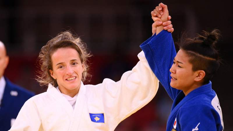 Kosovo's Distria Krasniqi (white) celebrates winning the judo women's -48kg final bout against Japan's Funa Tonaki during the Tokyo 2020 Olympic Games at the Nippon Budokan in Tokyo on July 24, 2021.( Photo by FRANCK FIFE/AFP via Getty Images)
