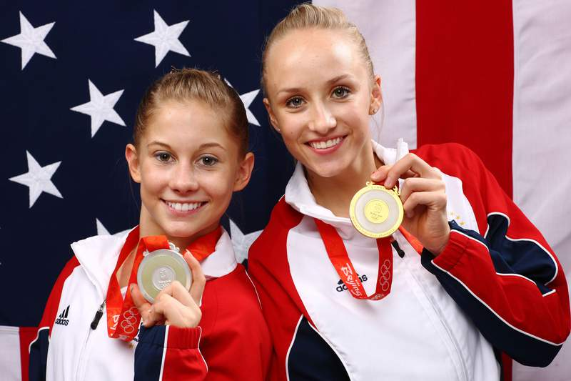 Shawn Johnson and Nastia Liukin of the United States pose together with their medals from the Women's All-Around Gymnastics event at the Beijing 2008 Olympic Games.