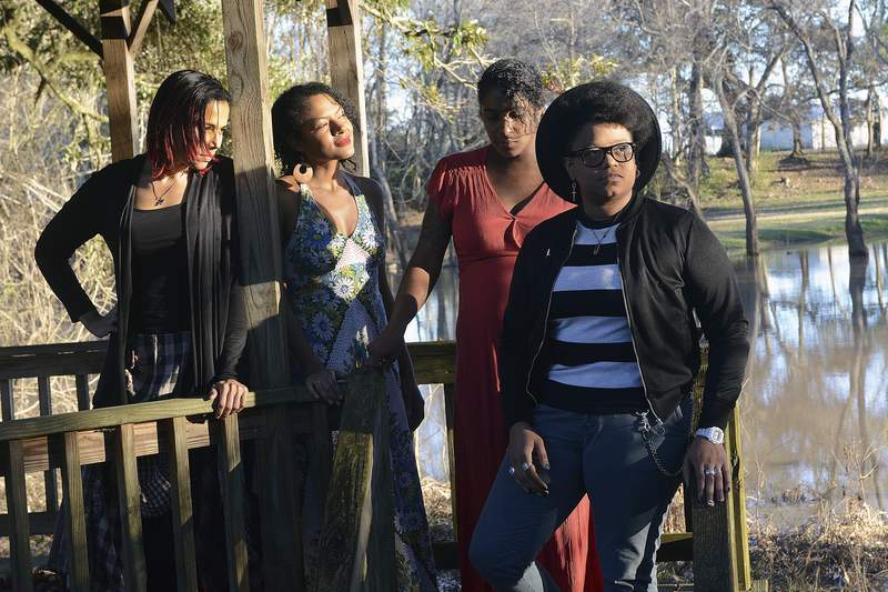 """This image released by Smithsonian Channel shows, from left, Rhiannon Giddens, Allison Russell, Leyla McCalla and Amythyst Kiah, of Our Native Daughters, near Parks, La., on Jan. 29, 2018. The group will appear in the documentary """"Reclaiming History: Our Native Daughters""""  premiering Monday on Smithsonian Channel. (Terri Fensel/Smithsonian Channel via AP)"""