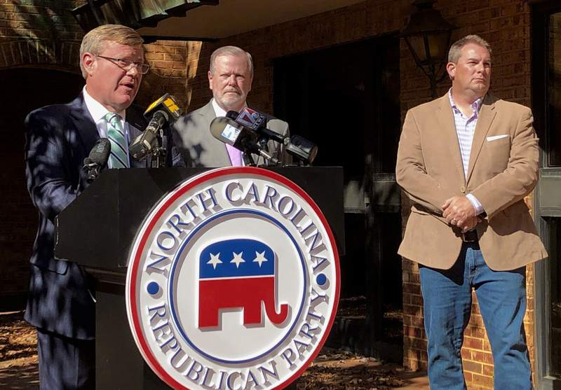 North Carolina House Speaker Tim Moore, left, R-Cleveland, speaks to reporters, with Senate leader Phil Berger, R-Rockingham, and House Majority Leader John Bell, right, R-Wayne, at a news conference on Wednesday, Nov. 4, 2020 at state GOP headquarters in Raleigh, N.C., to discuss Election Day results (AP Photo/Gary D. Robertson).