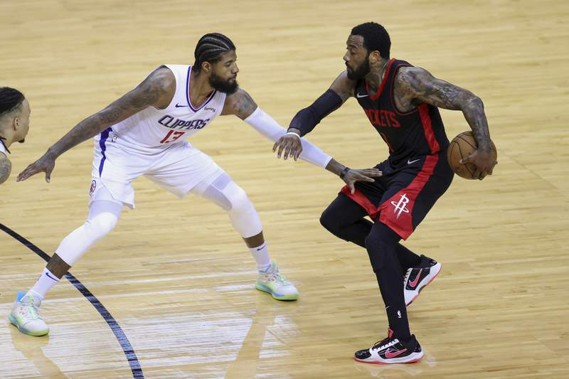 Houston Rockets' John Wall, right, works against Los Angeles Clippers' Paul George during the third quarter of an NBA basketball game Friday, April 23, 2021, in Houston. (Carmen Mandato/Pool Photo via AP)