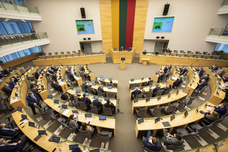 FILE - In this file photo dated Tuesday, Nov. 24, 2020, inside Lithuania's parliament in Vilnius, Lithuania.  Lithuania has detained nine Iraqi asylum-seekers who had entered the Baltic country from Belarus, officials said Monday June 7, 2021, pointing a finger at Belarus for allegedly being involved in sending repeated groups of immigrants into Lithuania.(AP Photo/Mindaugas Kulbis, FILE)