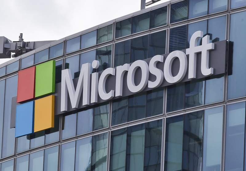 FILE - This April 12, 2016 file photo shows the Microsoft logo in Issy-les-Moulineaux, outside Paris, France. Microsoft took five hours to resolve a major outage of its workplace applications on Monday, but has not clarified what caused the outage. The company said the outage, which affected users ability to log into Office 365 applications, began early evening Monday Eastern time. Microsoft did not reply to questions Tuesday, Sept. 29, 2020 about what caused the outage, but said on its service-status Twitter account that it had identified a recent change that caused problems. (AP Photo/Michel Euler, File)