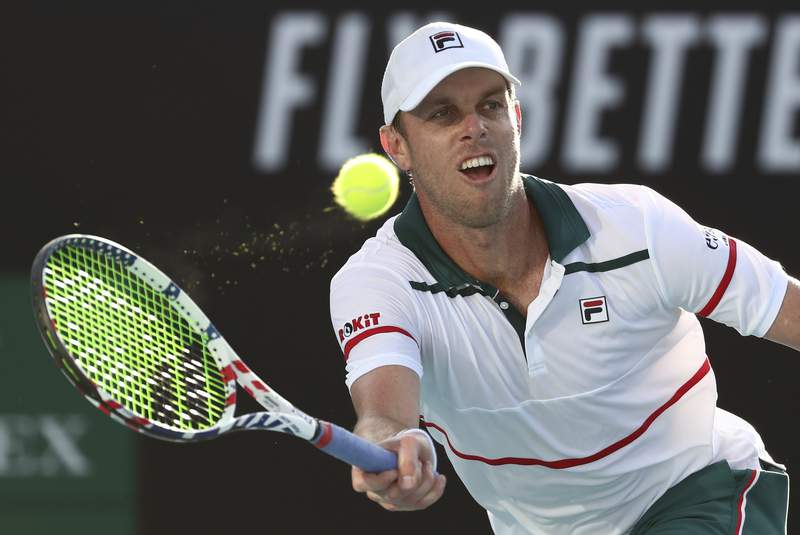 FILE - In this Friday, Jan. 24, 2020 file photo, Sam Querrey of the U.S. makes a forehand return to compatriot Tennys Sandgren during their third round singles match at the Australian Open tennis championship in Melbourne, Australia. U.S. tennis player Sam Querrey was placed in isolation by Russian authorities after testing positive for the coronavirus but left the country on a private plane, organizers of the St. Petersburg Open said on Thursday Oct. 15, 2020. (AP Photo/Dita Alangkara, File)