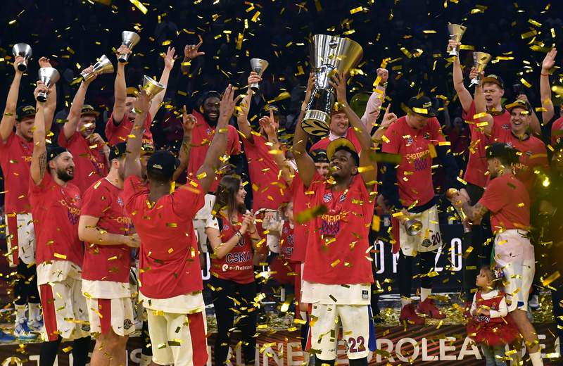 FILE - In this Sunday, May 19, 2019. file photo, Moscow players celebrate as they win the Final Four Euroleague final basketball match between Anadolu Efes Istanbul and CSKA Moscow at the Fernando Buesa Arena in Vitoria, Spain. The EuroLeague is hoping to have fans back at its Final Four this May in Cologne, Germany. The signature event of European basketball was called off last year because of the pandemic. (AP Photo/Alvaro Barrientos, File)