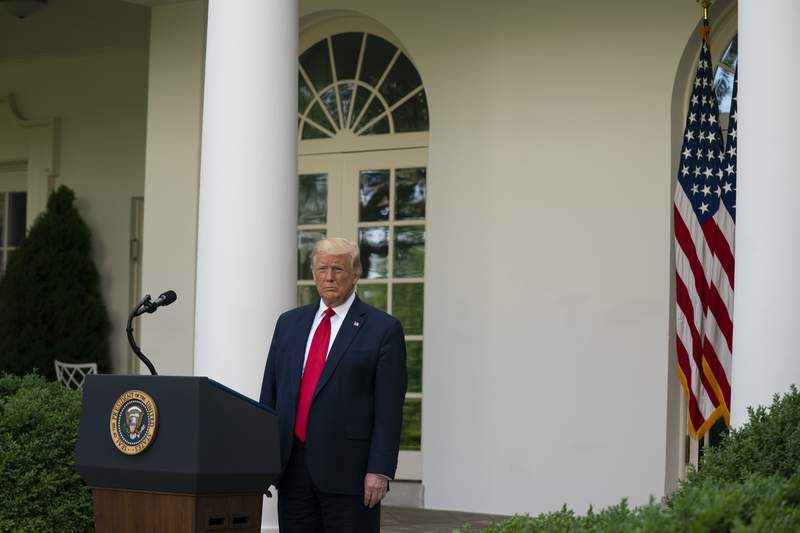 President Donald Trump listens as Vice President Mike Pence speaks during an event on protecting seniors with diabetes in the Rose Garden White House, Tuesday, May 26, 2020, in Washington. (AP Photo/Evan Vucci)