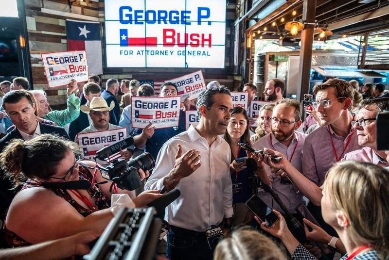 Texas Land Commissioner George P. Bush speaks to members of the media after announcing his candidacy for Texas Attorney General at an event inside Buford's Bar in Austin on June 2, 2021.