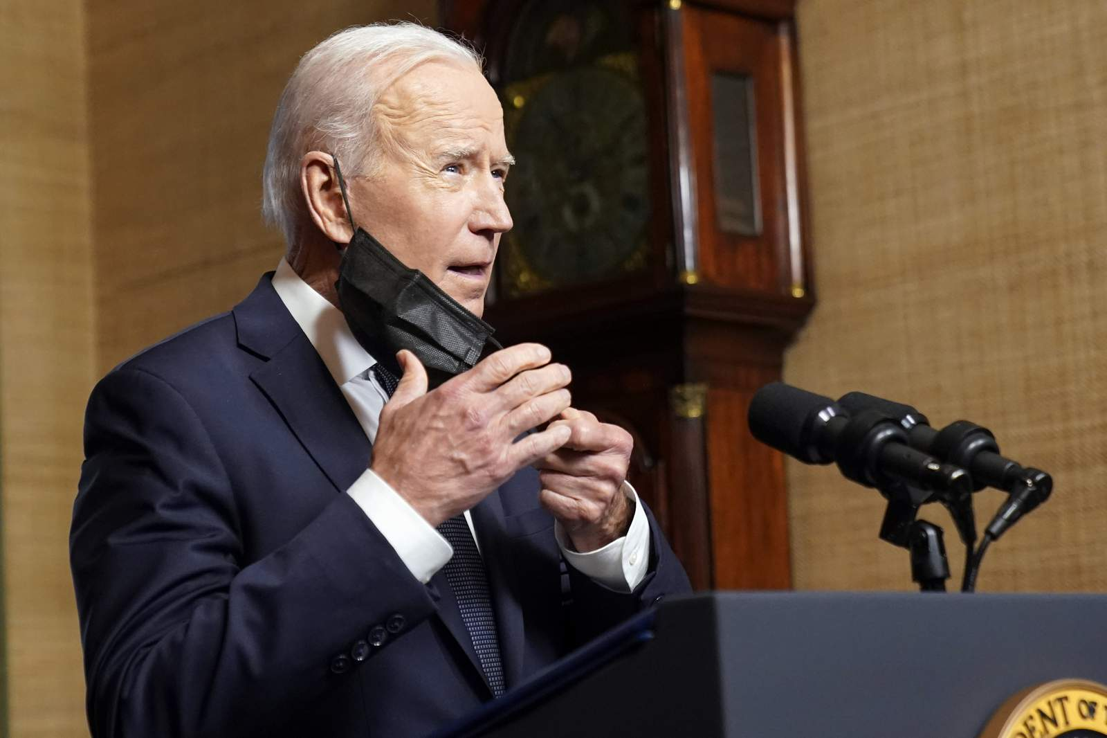 President Joe Biden takes off his face mask as he begins to speak from the Treaty Room in the White House on Wednesday, April 14, 2021, about the withdrawal of the remainder of U.S. troops from Afghanistan. (AP Photo/Andrew Harnik, Pool)