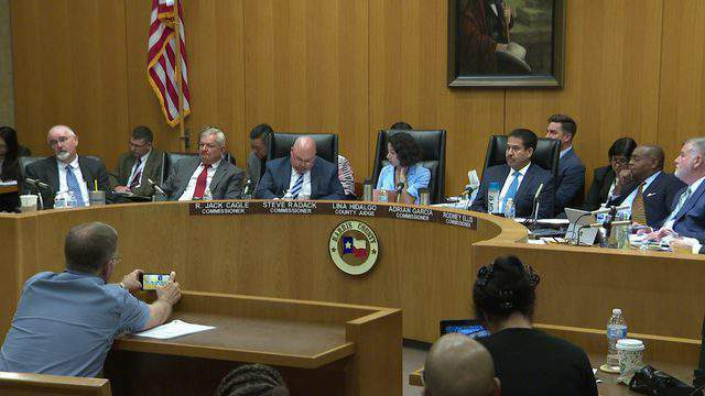 Members of the Harris County Commissioner's Court meet in downtown Houston on June 26, 2019.