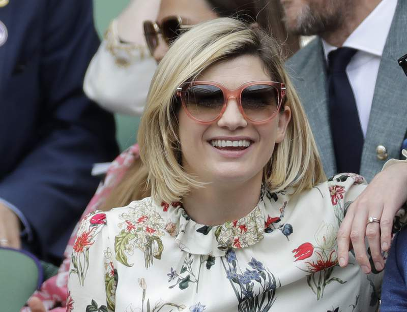 FILE - In this file photo dated Saturday, July 13, 2019, actress Jodie Whittaker sits in the Royal Box on Centre Court to watch the women's singles final match between Serena Williams of the United States and Romania's Simona Halep on day twelve of the Wimbledon Tennis Championships in London.  The BBC said Thursday July 29, 2021, that star Jodie Whittaker will leave the Doctor Who science fiction series next year, but before leaving Whittaker will appear in a new six-episode series in 2021 and three special episodes in 2022.(AP Photo/Ben Curtis, FILE)