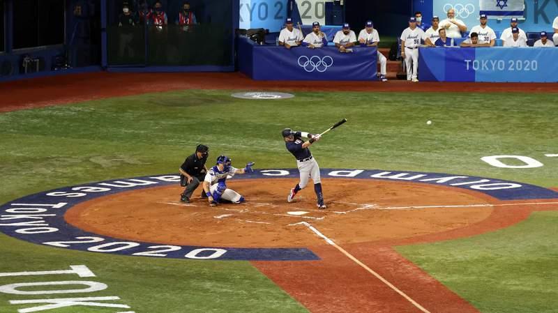 Tyler Austin drives the ball in the U.S. baseball team's Olympic opener against Israel on Friday.