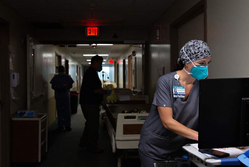 Nurse practitioner Cheryl Shovan inputs patients data in the halls of the COVID-19 care unit at Titus Regional Medical Center in Mount Pleasant on Aug. 19, 2021. The hospital is short of at least 20 nurses needed to handle the surge of COVID-19 cases in the Titus County area.