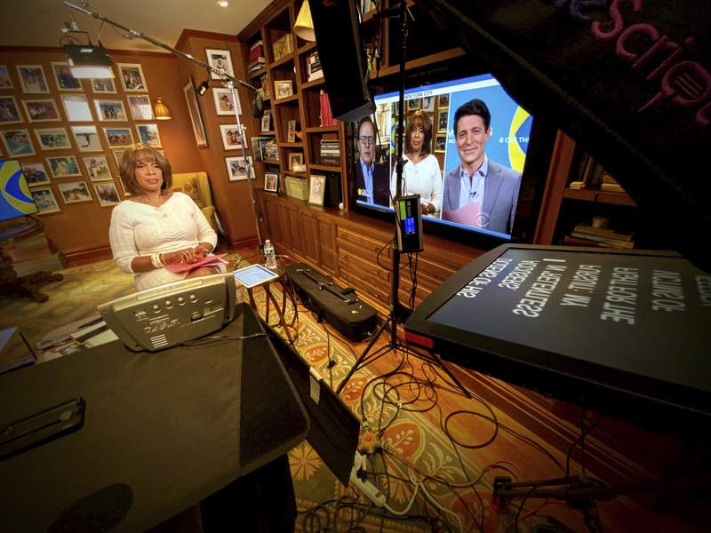 """This image released by CBS shows Gayle King of """"CBS This Morning"""" broadcasting from her home. More than most news programs, morning shows on ABC, CBS and NBC thrive by fostering a sense that its personalities are a chummy family. Now, due to coronavirus restrictions, those family members appear onscreen in dislocated boxes, and you're invited into their homes instead of vice versa. (CBS via AP)"""