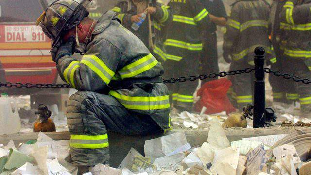A firefighter breaks down after the World Trade Center buildings collapsed Sept.11, 2001, after two hijacked airplanes slammed into the twin towers in a terrorist attack. (Photo by Mario Tama/Getty Images)