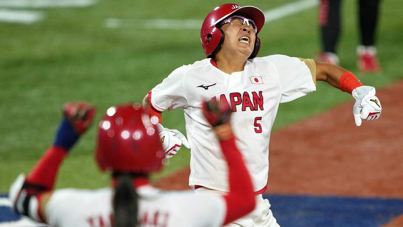 Japan third baseman Yu Yamamoto reacts after scoring against the United States during the fifth inning in the softball gold medal game.