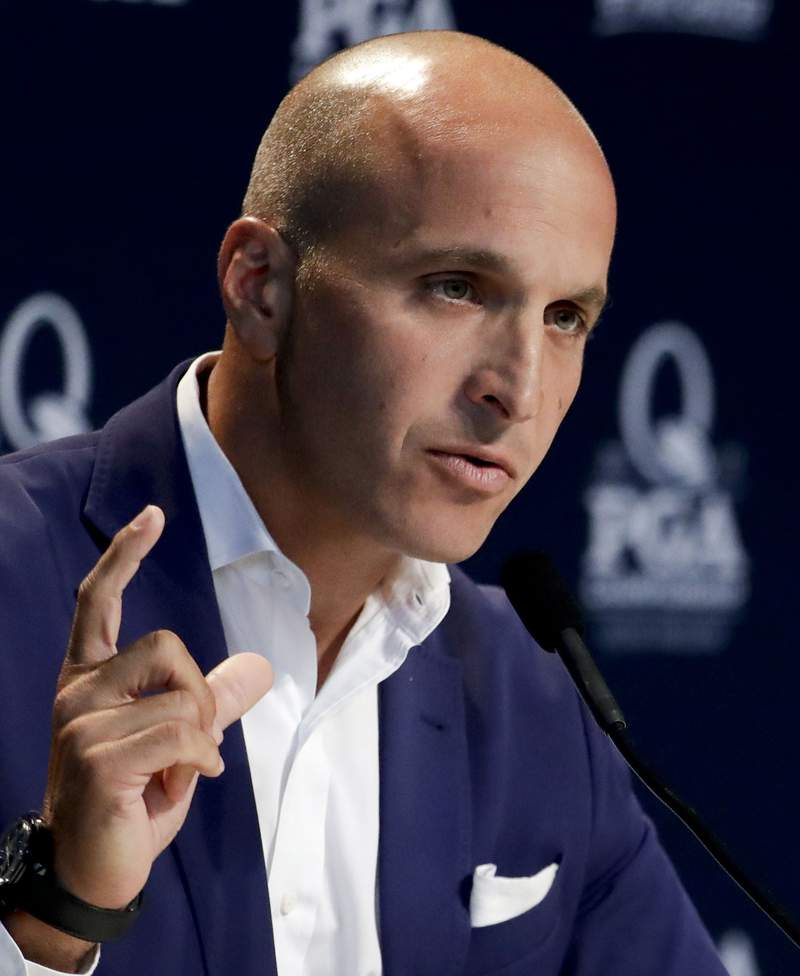 FILE - In this Aug. 8, 2017, file photo, Peter Bevacqua, then CEO of the PGA of America, speaks during a news conference at the PGA Championship golf tournament at the Quail Hollow Club in Charlotte, N.C. NBC will shut down the NBC Sports Network at the end of the year. NBC Sports Chairman Bevacqua announced the move Friday, Jan. 22, 2021, in an internal memo to staff. (AP Photo/Chris Carlson, File)