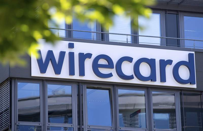 File---Picture taken June 24, 2020 shows the Wirecard logo at the headquarters of the payment service provider in Aschheim, Germany.  (Sven Hoppe/picture-alliance/dpa via AP, file)