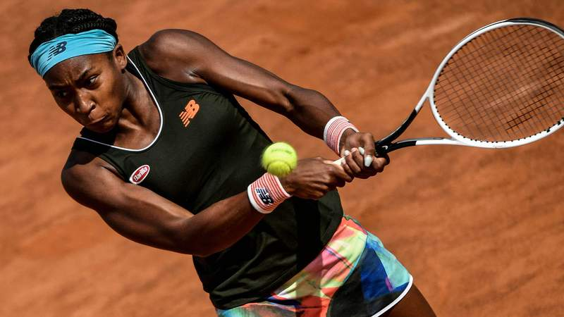 US Cori Gauff goes to return a backhand to Poland's Iga Swiatek during their semifinal match of the Women's italian Open at Foro Italico on May 15, 2021 in Rome.