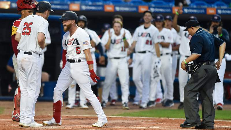 United States' Eric Filia (5) celebrates hitting a home run with teammate Todd Frazier (25) during the fourth inning against Venezuela in a Baseball Americas Qualifier on Saturday, June 5, 2021, at Clover Park in Port St. Lucie. Team USA won 4-2.