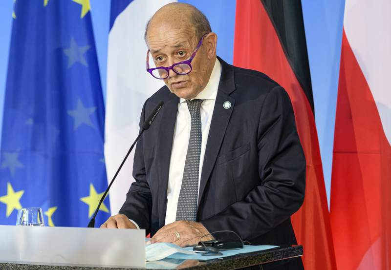 FILE - In this Friday, Sept. 10, 2021 file photo, French Foreign Minister Jean-Yves Le Drian speaks in Weimar, Germany. France said late Friday, Sept. 17 it was immediately recalling its ambassadors to the U.S. and Australia after Australia scrapped a big French conventional submarine purchase in favor of nuclear subs built with U.S. technology. Foreign Minister Jean-Yves Le Drian said in a written statement that the French decision, on request from President Emmanuel Macron, is justified by the exceptional seriousness of the announcements made by Australia and the United States.(Jens Schlueter/Pool Photo via AP, file)