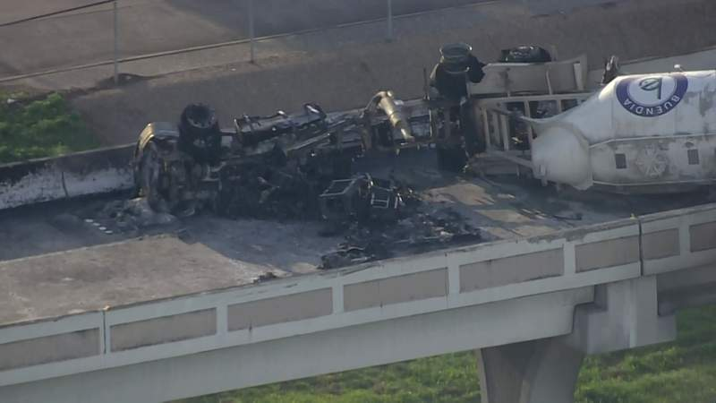 The charred wreckage of a fatal big-rig crash is seen on the Eastex Freeway in Houston on April 19, 2021.
