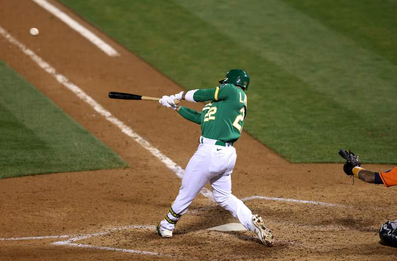 Ramon Laureano #22 of the Oakland Athletics hits the game-winning hit in the bottom of the ninth inning against the Houston Astros at RingCentral Coliseum on September 09, 2020 in Oakland, California.