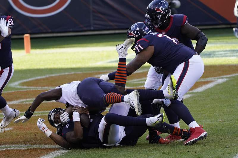 Houston Texans quarterback Deshaun Watson (4) is sacked for a safety by Chicago Bears' Khalil Mack (52) during the first half of an NFL football game, Sunday, Dec. 13, 2020, in Chicago. (AP Photo/Charles Rex Arbogast)
