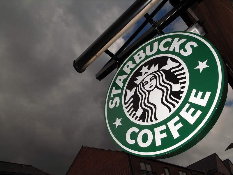 The Starbucks logo hangs outside one of the company's cafes.