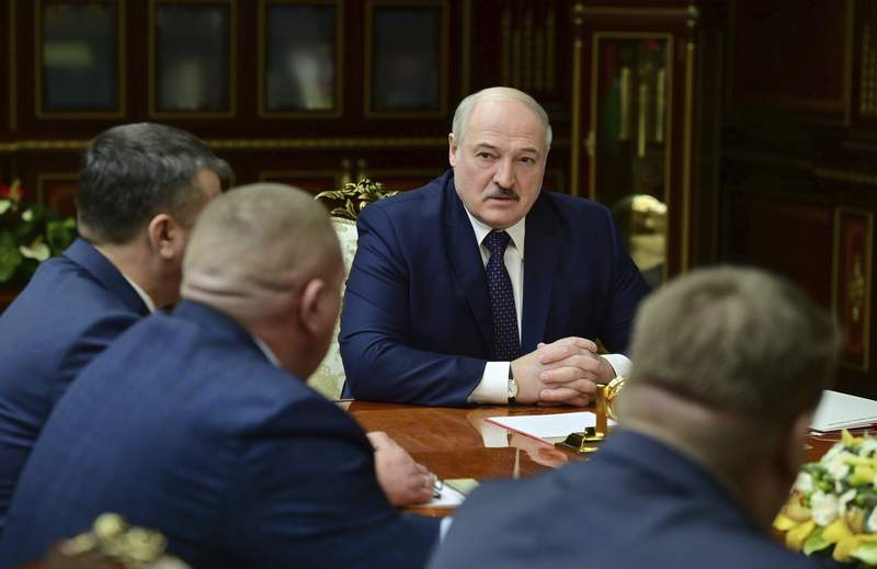 Belarusian President Alexander Lukashenko attends a meeting with top officials in Minsk, Belarus, Tuesday, Jan. 26, 2021. (Andrei Stasevich/BelTA Pool Photo via AP)