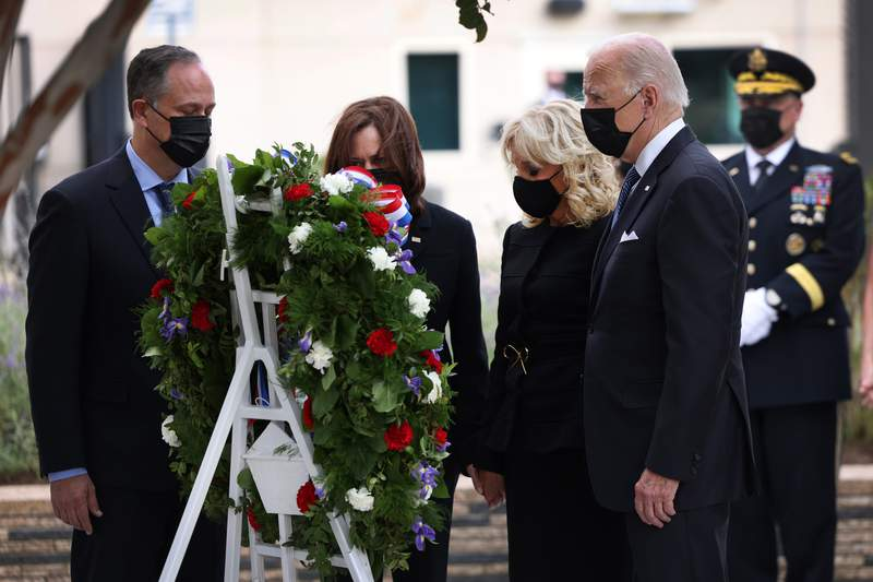 ARLINGTON, VIRGINIA - SEPTEMBER 11: President Joe Biden, First Lady Jill Biden, Vice President Kamala Harris and Second Gentleman Doug Emhoff attend a wreath-laying ceremony at the National 9/11 Pentagon Memorial on September 11, 2021 in Arlington, Virginia. The nation is marking the 20th anniversary of the terror attacks of September 11, 2001, when the terrorist group al-Qaeda flew hijacked airplanes into the World Trade Center, Shanksville, PA and the Pentagon, killing nearly 3,000 people.  (Photo by Kevin Dietsch/Getty Images)